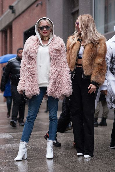 Shea Marie and Caroline Vreeland are seen attending Public School during New York Fashion Week wearing fringe and fur coats on February 12 2017 in...