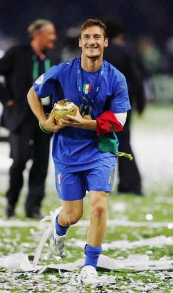 Francesco Totti of Italy holds the World Cup trophy following his team's victory in a penalty shootout at the end of the FIFA World Cup Germany 2006...