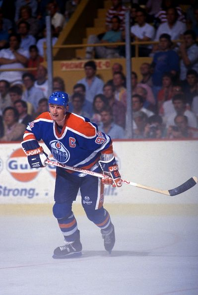 Wayne Gretzky of the Edmonton Oilers skates through fog on the ice during Game 4 of the 1988 Stanley Cup Finals against the Boston Bruins on May 24...