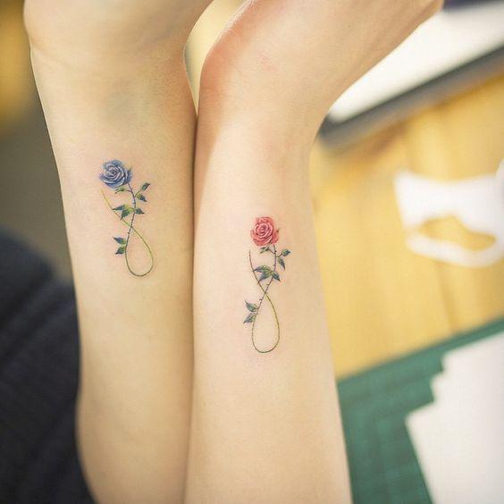 matching rose tattoos on arms
