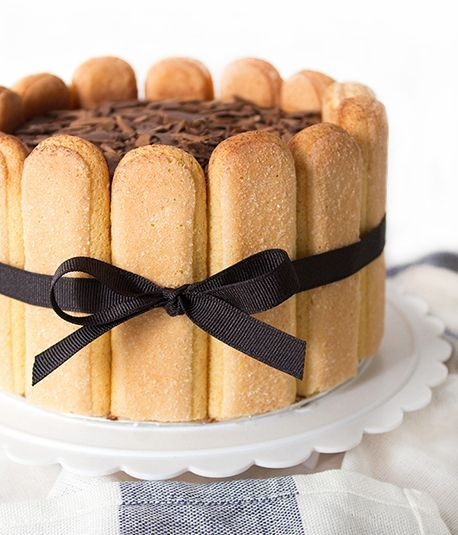Tiramisu Charlotte Recipe - Creamy, delicious mascarpone layers with coffee dipped lady fingers -what a treat! From Bake & Bait − baking, cooking and everything in between