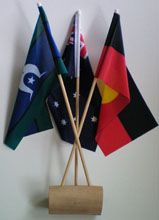 Aboriginal - Australian - TSI Desk Flags & Stand  timber stand height: 41cm made in Australia  Price:- 1-9 @ $31.50 ea 10-19 @ $31.00 ea 20+ @ $29.00 ea