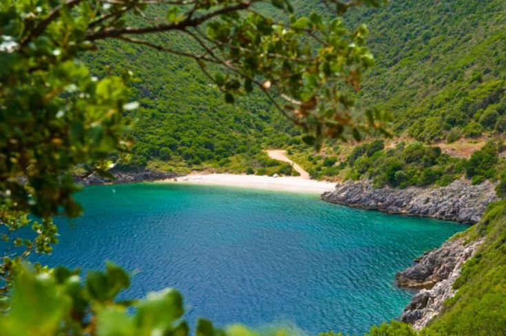Kaminia is an impressive, pebbled beach, situated at the foot of a green hill, offering a magestic background for your summer dives. #Greece #Ithaca #Terrabook #GreekIslands #Travel #GreeceTravel #GreecePhotografy #GreekPhotos #Traveling #Travelling #Holiday #Summer