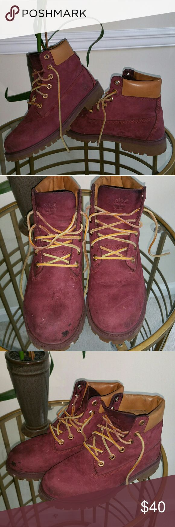Oxblood Timberland Boots Details: Oxblood Tims trimmed in classic tan leather.   Condition: Good condition. Cleaning would be needed as there is a stain on left shoe on top along with with small stains on both boots. Nothing a good cleaning can't fix. Price reflects As-Is sale.  Please ask any questions that you may have or request additional photos Timberland Shoes Combat & Moto Boots