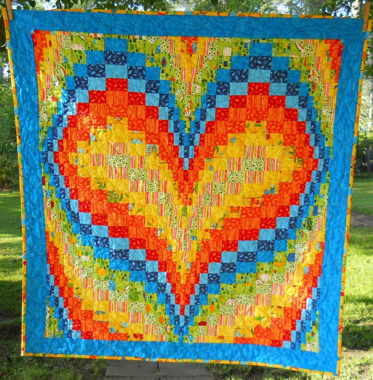 love the pattern... but I would do the aqua with green, pink and soft colors to match what I  have in my house...    Bargello Heart Quilt by smockingRN of the quiltingboard.com