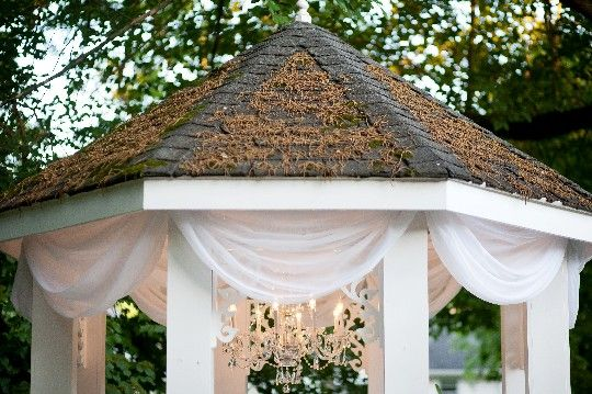 We love this combination of chandelier and draping on the garden gazebo. It is a simple and elegant backdrop for your garden wedding at CJ's Off the Square.