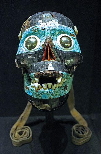 Aztec mosaic mask of Tezcatlipoca  (mexica) _The skull of the smoking mirror... The mexicas belived that the defeat of Quetzalcoaltl by Tezcaltlipoca marked the beginning of the current era of creation.The decoration is worked in alternate bands of bright blue turquoise and black mosaic.The eyes are made of two orbs of  polished pyrite framed by rings of white conch shell.The nasal cavity is lined with plates of red shell. From  Mexico Tenochtitlan