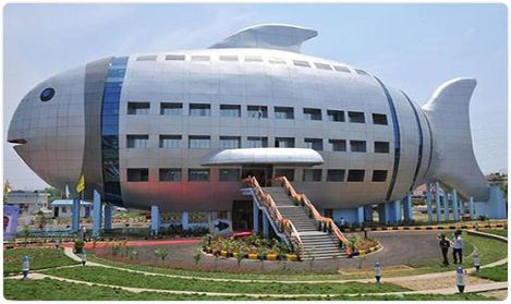 """FISHERIES DEPARTMENT , Hyderabad, INDIA. This humorous fish-shaped building is a regional office for the National Fisheries Development Board located near Hyderabad, India. According to Outlook India, the 4-story building is inspired by a """"giant fish sculpture in Barcelona,"""" presumably the 1992 monumental sculpture """"Fish,"""" by Frank Gehry. The building officially opened in April 2012."""
