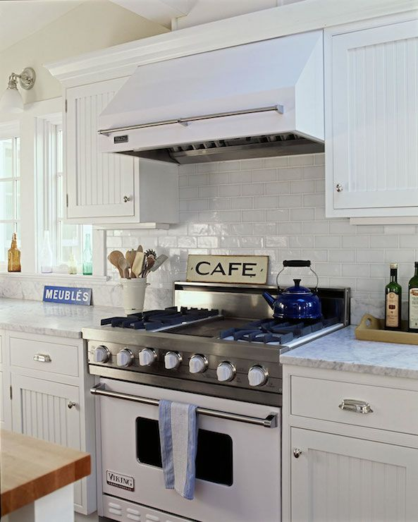 Exceptional ... Kitchen With White Beadboard Cabinets With Polished Nickel Hardware,  White Marble Countertops And A White Subway Tiled Backsplash Over A White  Viking ...