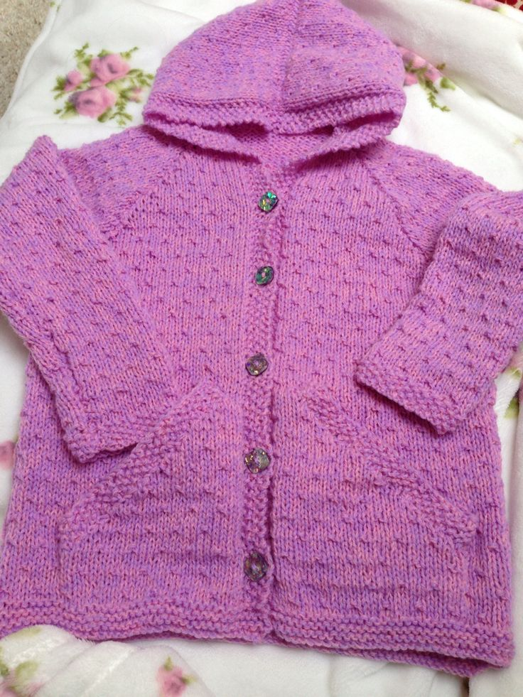 I hand knitted this girls hoodie using 2 different coloured strands of 4ply together. Vintage buttons add sparkle. A lovely fit for a lovely wee girl.