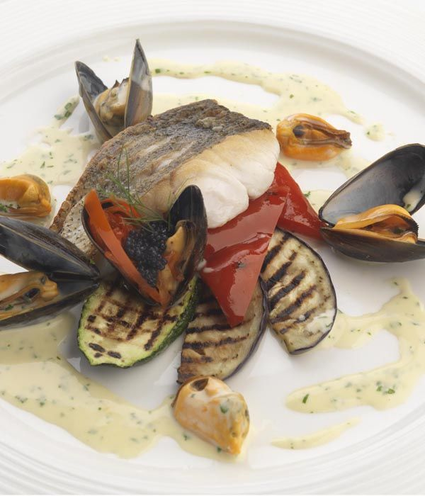 A visually striking dish full of clean flavours, renowned Brazilian chef Marcello Tully has developed this elegant hake fillet recipe, which combines the fish with mussels, chargrilled aubergines, red peppers and courgettes.