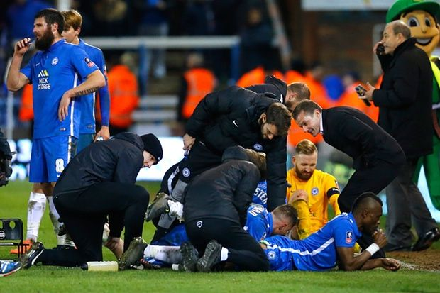 Peterborough United manager Graham Westley gees up his players as they receive treatment before extra time in the FA Cup replay with West Brom.