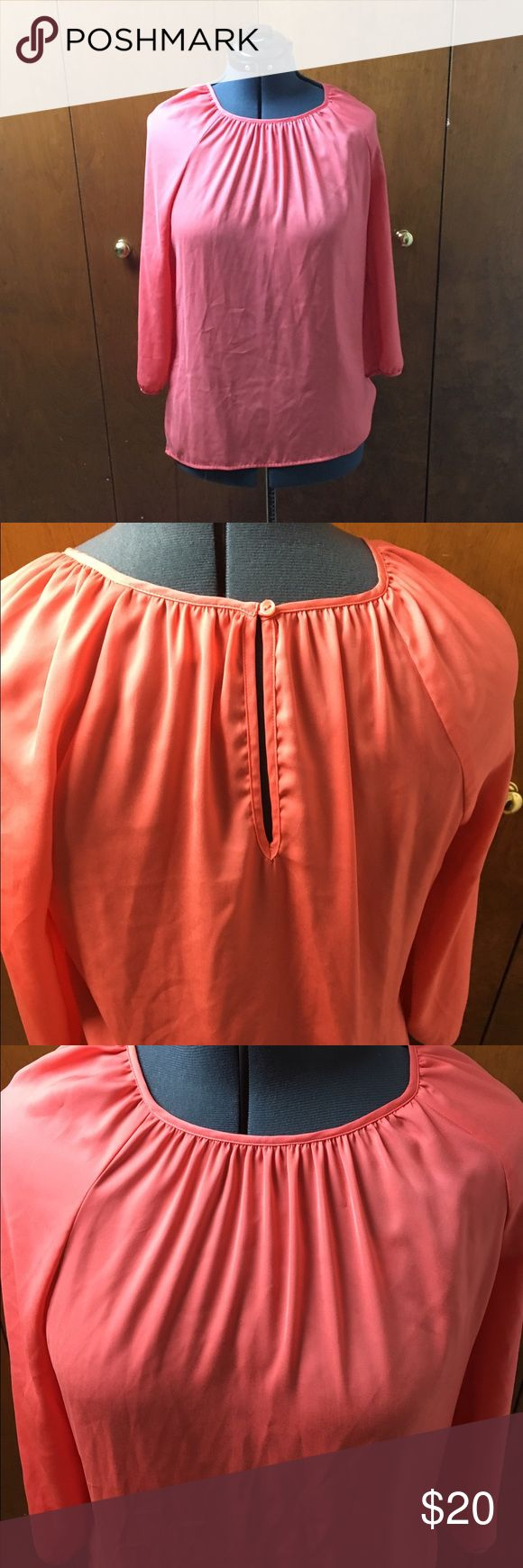Old Navy Coral Blouse Size Large Such a pretty color. 3/4 length sleeve with the key hole in the back. Color is a coral from Old Navy Old Navy Tops Blouses