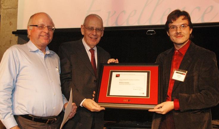 From left, Associate Dean Gary Spraakman, Dean Martin Singer and Mykola Zabara, winner of the Dean's Award for Academic Excellence.