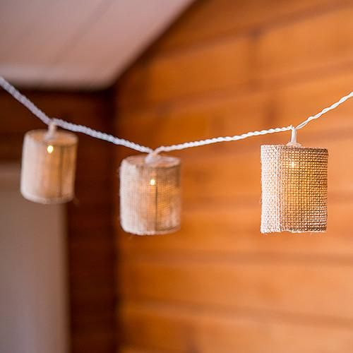 Add natural sparkle to Rustic Weddings, Barn Weddings or Western weddings with...String Of LED Lights With Natural Burlap Shades..battery powered LED lights..tables, suspend overhead, line the wedding aisle, table tops, add to centerpieces and more.