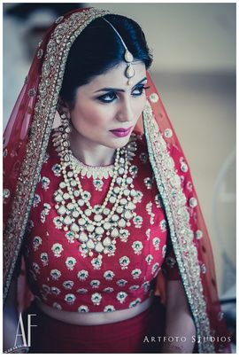 Bridal Portrait - Red Bridal Portrait | WedMeGood | Bride in a High Neck Blouse with Polki Jewelry  #wedmegood #indianbride #indianwedding #polki #jewelry