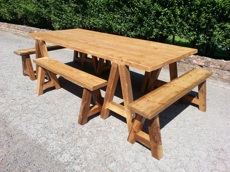Carpenter style table and benches made from reclaimed pine.