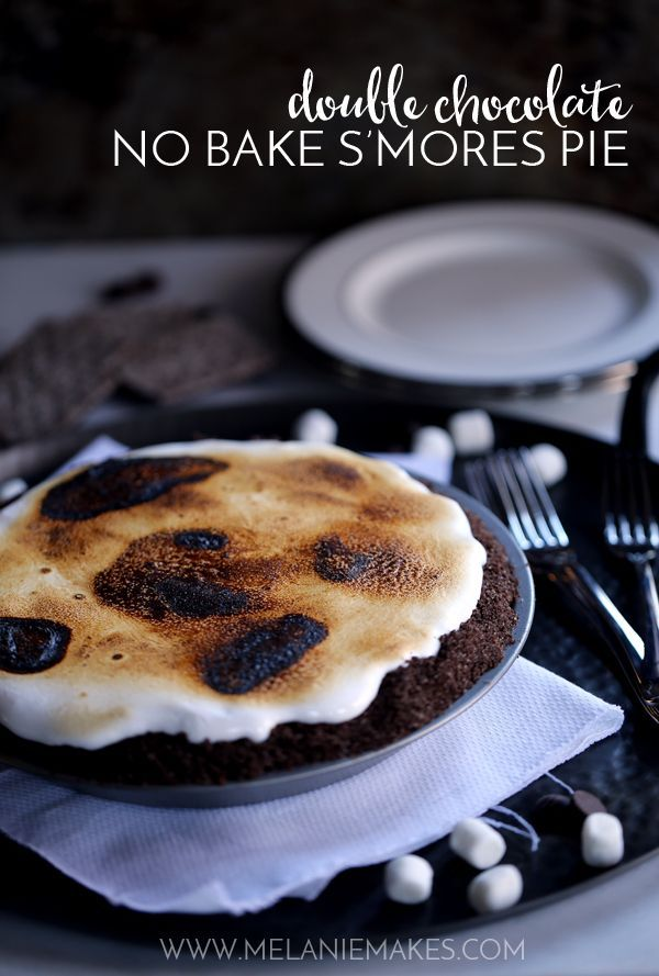 My six ingredient Double Chocolate No Bake S'mores Pie is sure to please kids, kids at heart and anyone and everyone in between and couldn't be easier to make! A homemade chocolate graham cracker crust is filled with a pool of chocolate ganache before being topped with a cascading cloud of marshmallow fluff that's torched to campfire perfection.