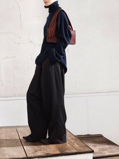 Oversized Turtleneck, $149; Oversized Trousers, $129; and Glove Clutch, $149.   Photo courtesy of H.