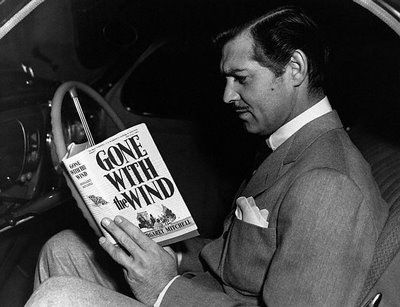 "Clark Gable reading the book that changed his career...""Frankly, my dear, I don't give a damn."" (In the book, the actual line is, ""My dear, I don't give a damn)."
