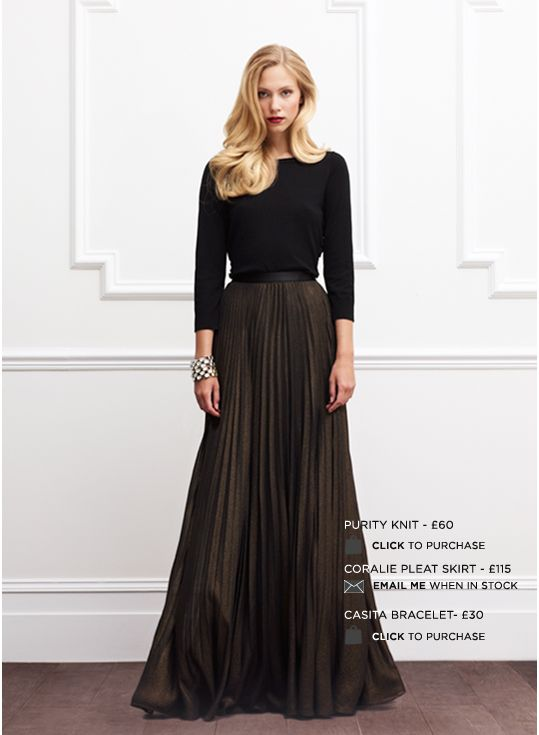Long sleeved evening gown with pleated metallic skirt