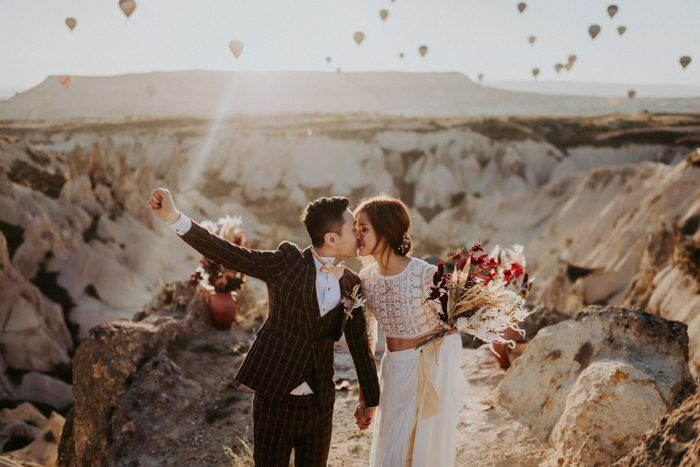 Unique Elopement Alert This Couple Exchanged Vows Among Over 100 Hot Air Balloons In Cappadocia Turkey Junebug Weddings In 2020 Wedding Ceremony Pictures Wedding Ceremony Cheap Wedding Photographers