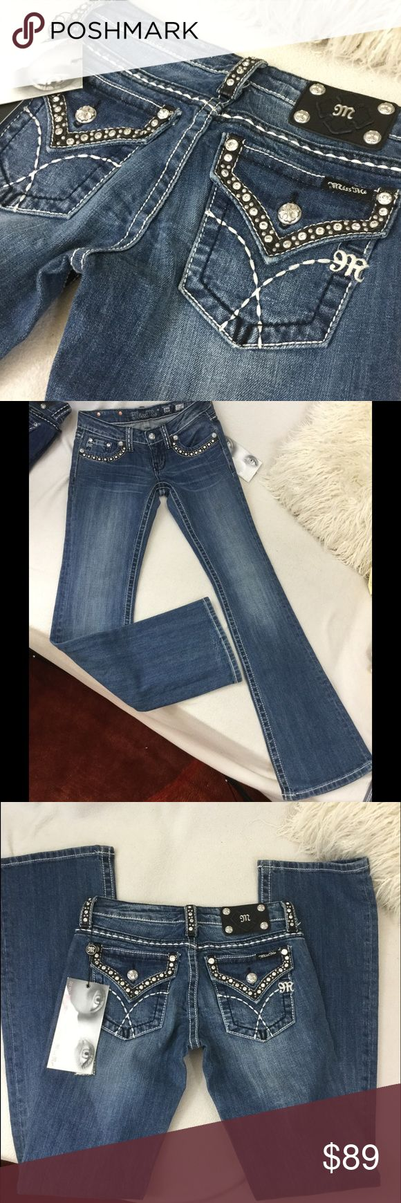 """Miss Me BRAND NEW Leather/Rhinestone  jeans Miss Me BRAND NEW boot cut jeans. Edgy black leather detail with rhinestones on pockets and belt loops. Excellent condition never worn. Inseam measures 33.5"""" long 14"""" across waist and a 7.5"""" front rise Miss Me Jeans Boot Cut"""
