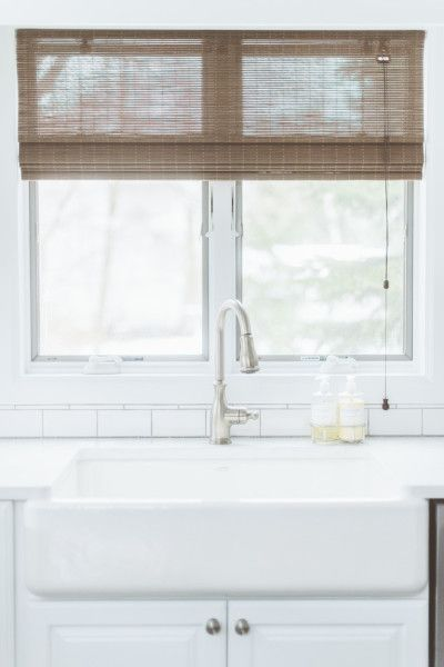 Dream kitchen sink with windows behind it- Eclectic Rustic Cottage Interior with Summer Beach Style Touches