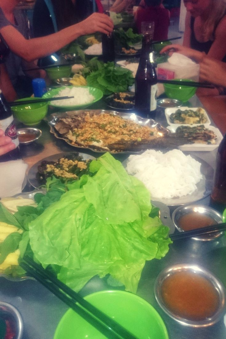 Vietnamese feast! River fish with peanuts put into rice paper together with rice noodles and a lot of greens!