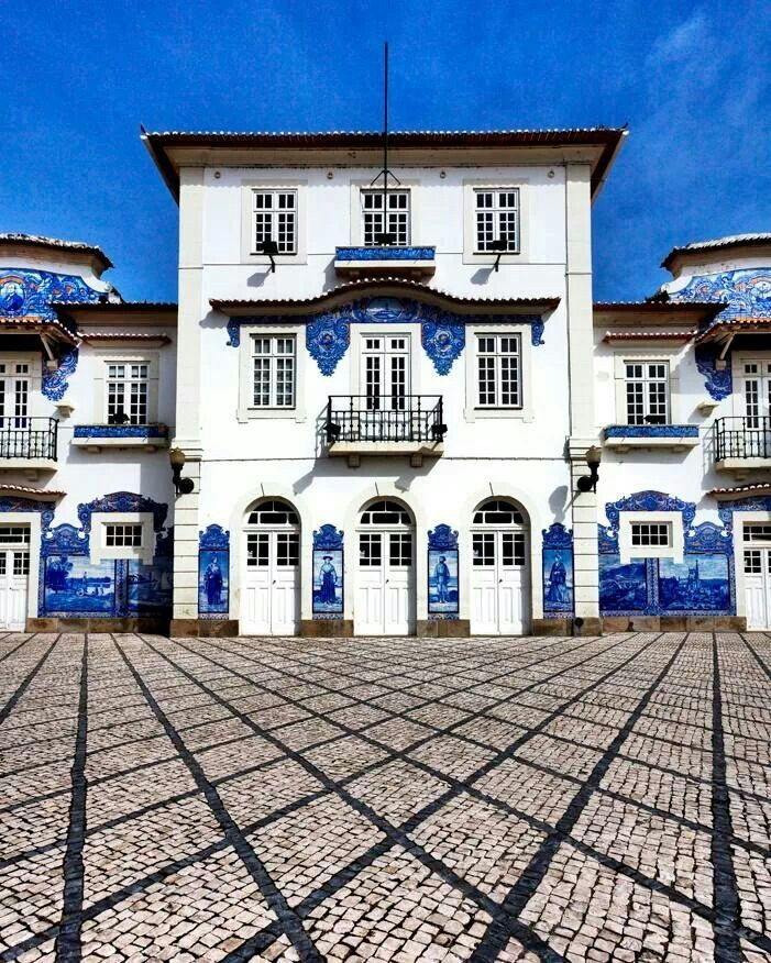 Portuguese railways station architecture: white buildings with azulejos (portuguese hand painted tiles) decorations - Aveiro main station