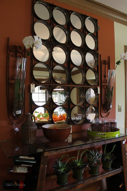 wall decor was made from mirrored cake pans and salvaged metal fence pieces.  It was gorgeous!  The wine rack/ table was made from salvaged wood.