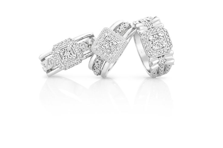 Princess cut diamond engagement rings with a bit of a broader band. Statement!