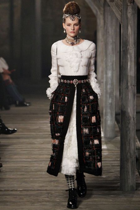 Chanel Pre-Fall 2013, skirt opened revealing under layer (petticoat), decorative belt around waist is exposed.
