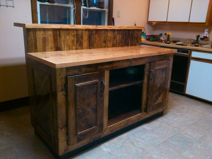 This Magnificent Two-tier Pallet Kitchen Island was built out of 8 pallets in only 40 hours! This would be a stunning focal point in any kitchen!