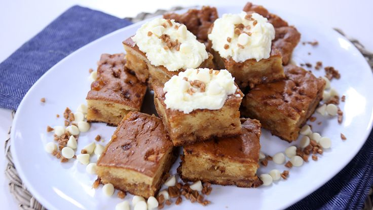 White chocolate toffee blondies with whipped cream frosting