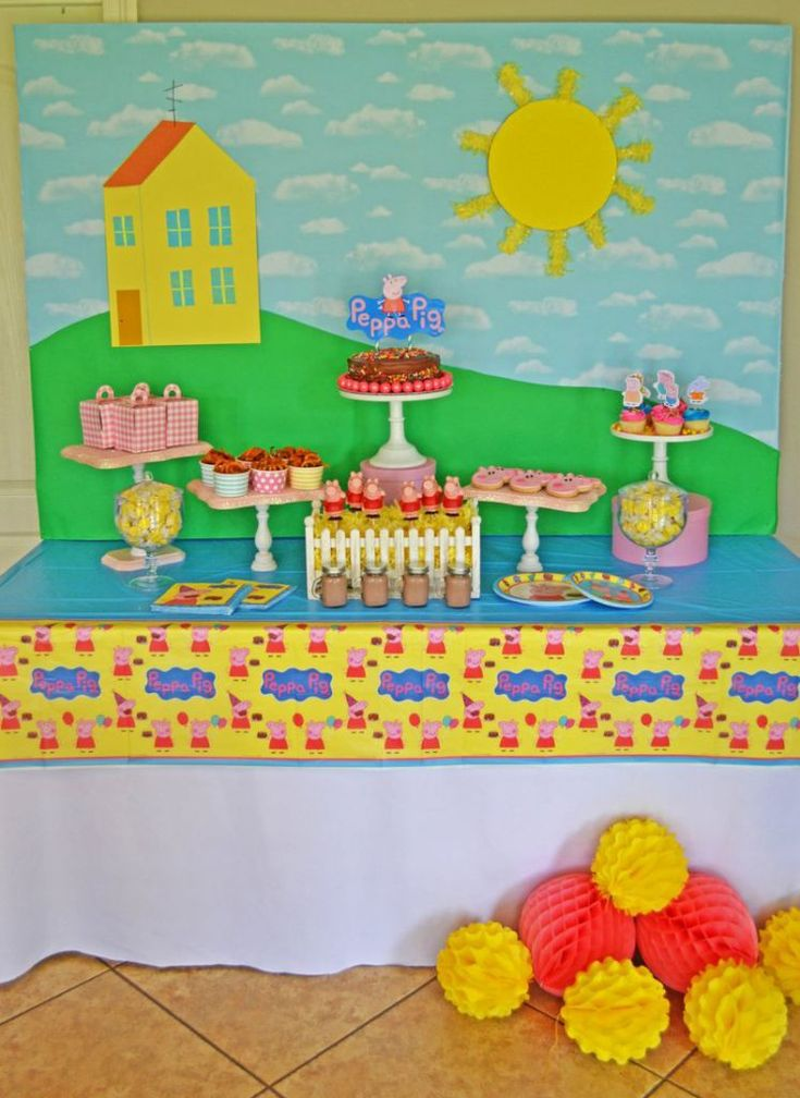 It's easy to create your own custom Peppa Pig backdrop for your child's next birthday party. Start with bulletin board party and layer with cloud-patterned paper. Cut a green piece to create the hill where Peppa's house is located. Use construction paper to create the house. The big sun can be created from craft foam and some yellow tissue festooning.