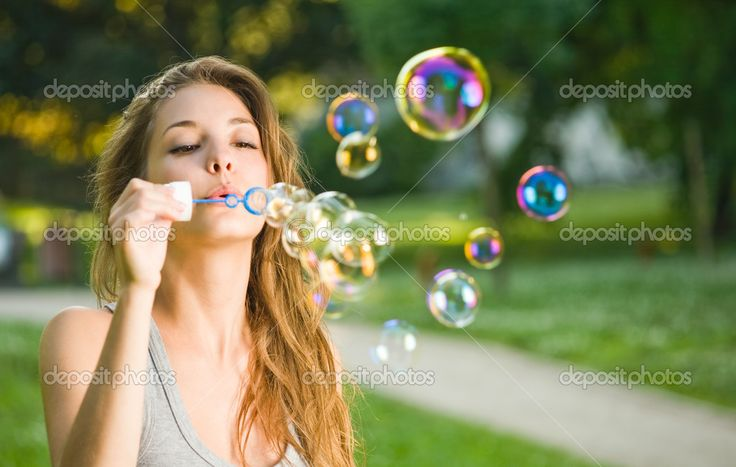 Blowing bubbles and enjoying the simple pleasures of life.