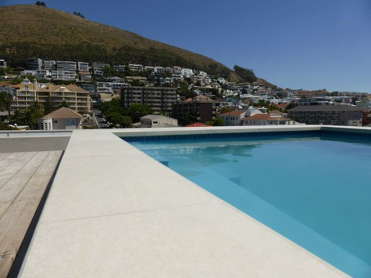 in Cape Town, South Africa. Brand new and comfortable 1 bedroom apartment in the heart of Cape Town. It comfortably fits 2 adults and a sleeping couch can welcome a 3rd adult or 2 kids. State of the art building with roof access: swimming pool and BBQ area with a great view,...
