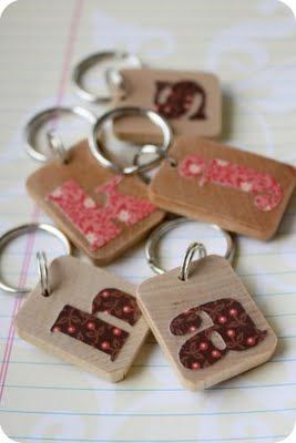 Wood Monogram Key Chains--mod podge paper letter onto wood chip--just that simple, with the right paper :)