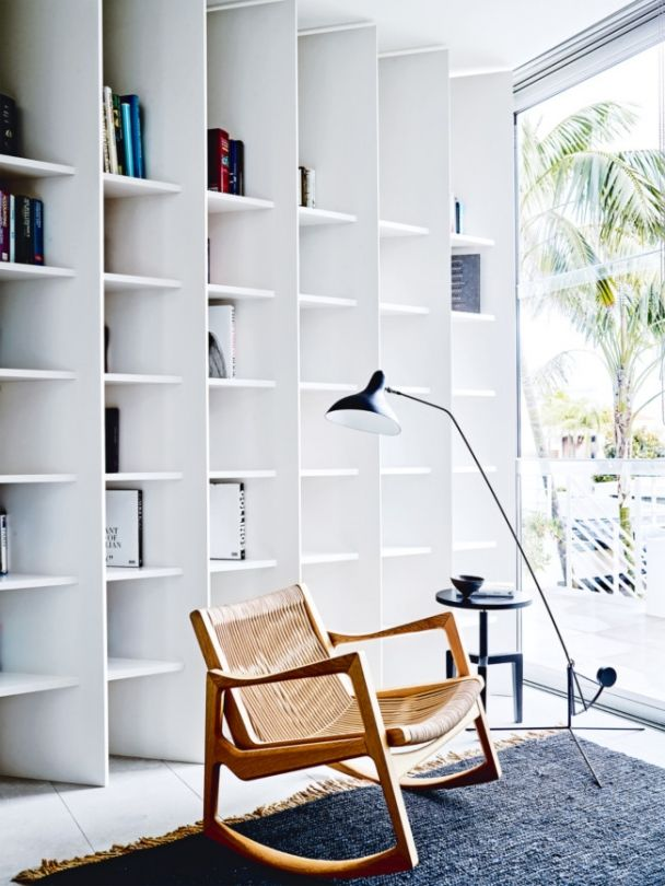 House tour: a sophisticated beachside Sydney home: In the study, a Classicon 'Euvira' rocker by Jader Almeida from Anibou, the DCW 'Mantis' floor lamp by Bernard Schottlander from Spence & Lyda and custome joinery by Hare + Klein. Go to hareklein.com.au and popovbass.com.au.