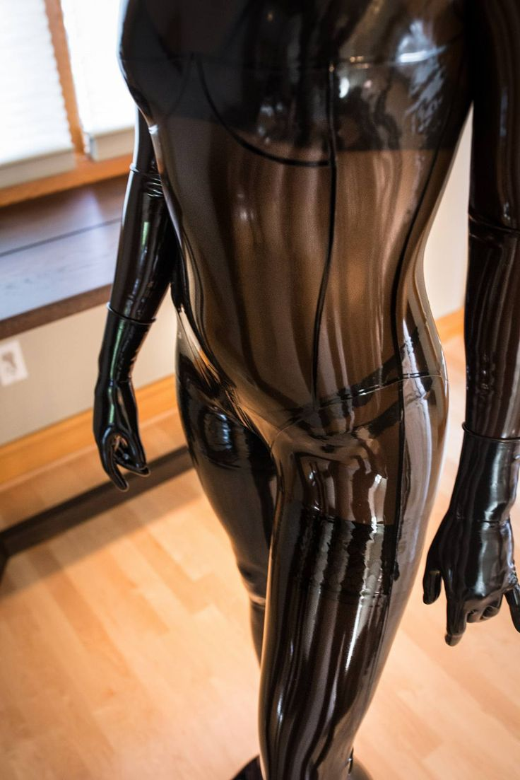 Gril in transparent latex catsuit