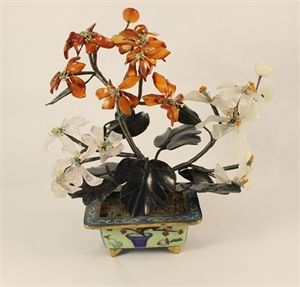 This arrangement of crystal flowers is a marvelous piece.  The flowers themselves are made of carnelian and quartz, the leaves are made of Jade and the base of this piece is Cloisonné.  Dated from the 1950's/1960's.