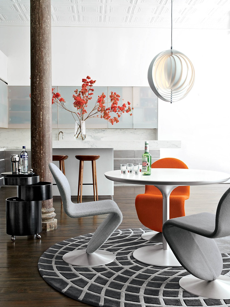 Gorgeous.   System 1-2-3 Dining Chairs, Panton Dining Table, Moon Pendant, Panton Rug, Duncan Vodka Glasses, Barboy, Tractor Stools.