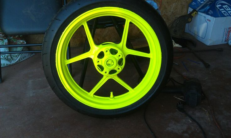 Love this tire and rim! Along with the blaze yellow plasti dip. Has a neon green tint if you don ...