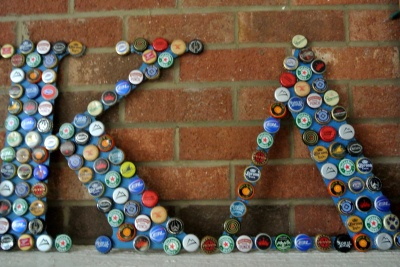 For the back deck... use bottle caps!  DIY Decorative Letters
