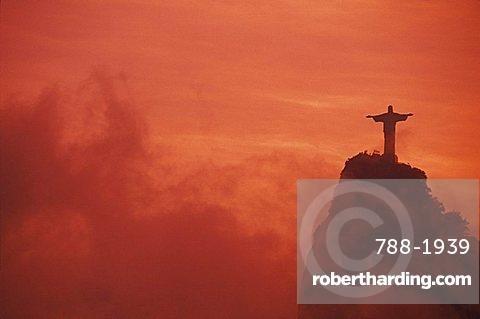 Statue of Jesus Christ on a hill at sunset, Christ the Redeemer Statue, Rio De Janeiro, Brazil