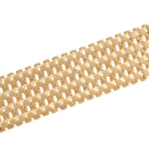 A wide and heavy retro gold bracelet. View our collection of antique, Art Deco, and modern jewellery at www.rutherford.com.au