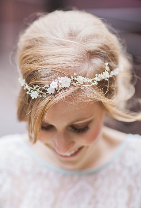 Brides.com: The Prettiest Wedding Hairstyles with Flower Crowns For a more delicate look, adorn your braids with pretty pink berries accented with dark greenery. The understated blushed hues and Grecian flair are a stylish departure from other statement-making crowns.Photo: Feather and Stone Photography