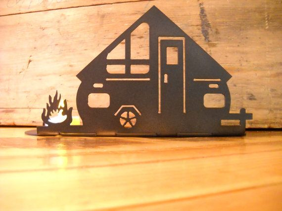 Happy Campers will love this depiction of their A-frame silhouette camper parked at the site with the campfire burning. Great to use in the camper or at home during off-season; as you count the days when you can hit the open road! Custom made to order from 14 gauge steel, painted textured black. Measures 10 long, 5 tall and 3 deep  Typical lead time is 3 to 5 days from order to shipping Please note: recommended to use battery tea lights for safe operation, if a real candle is used please be…