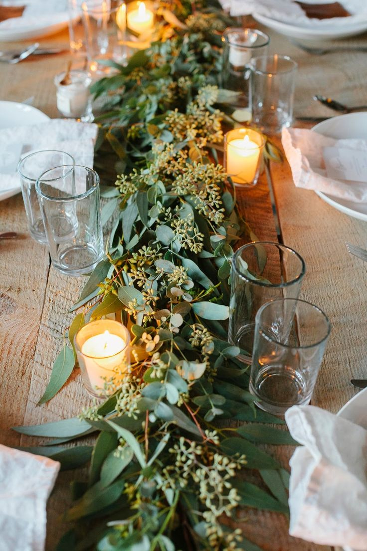 Beautiful, organic, lush floral table runners with candles throughout